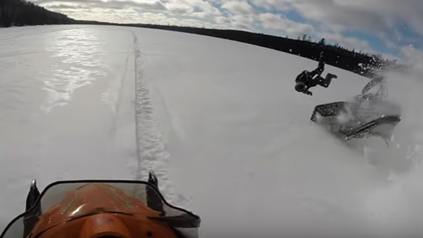 Man hurled over handlebars after losing control of snowmobile