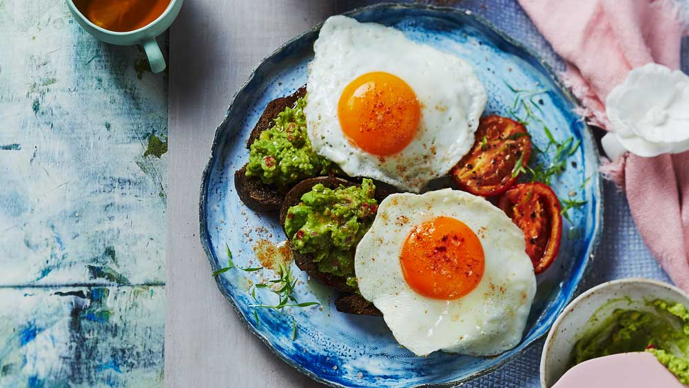 Fried eggs with spiced avocado