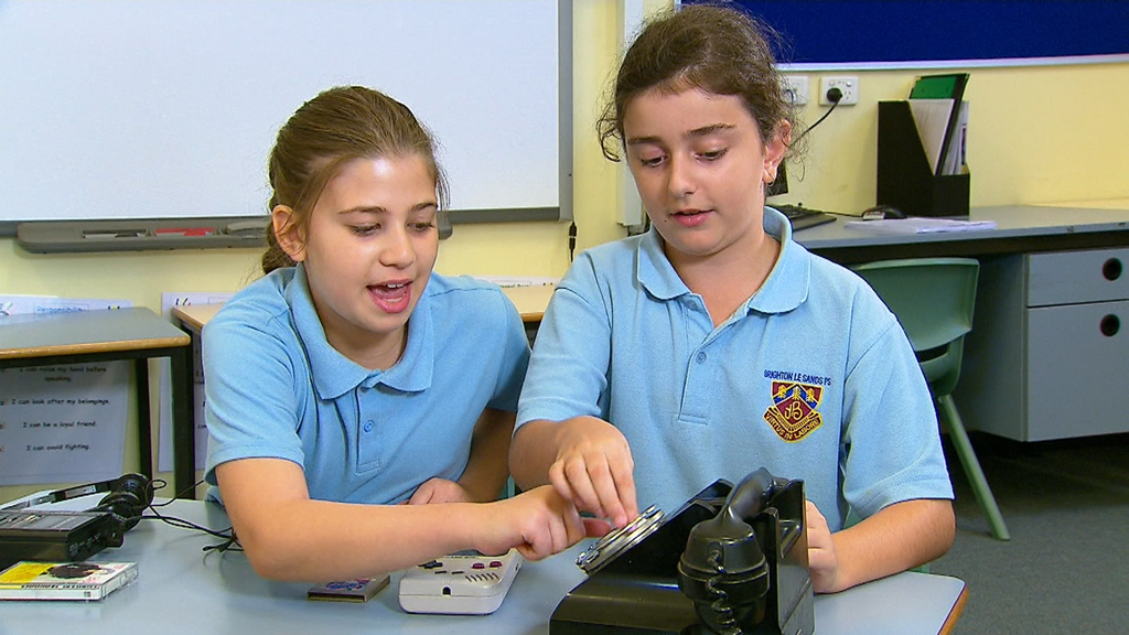 The children were handed three pieces of technology. (9NEWS)