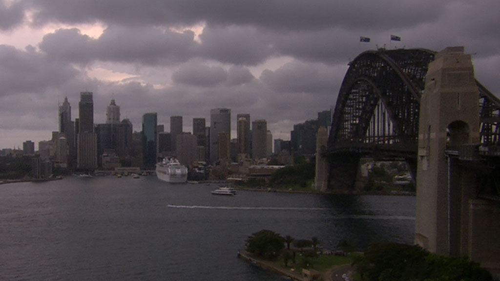 The sky darkens over Sydney's CBD.