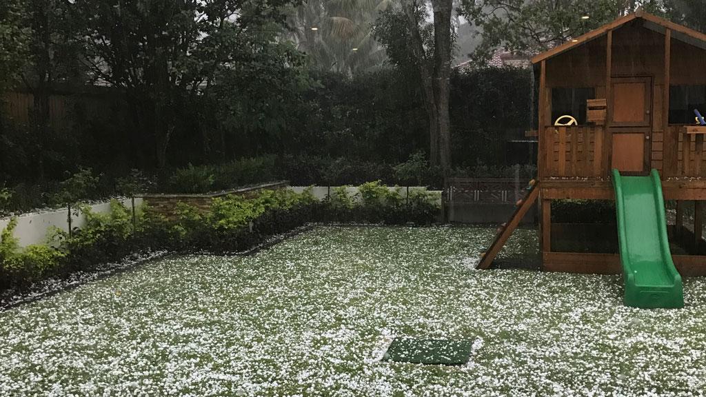 Hail blankets a backyard in Pymble. (Supplied)