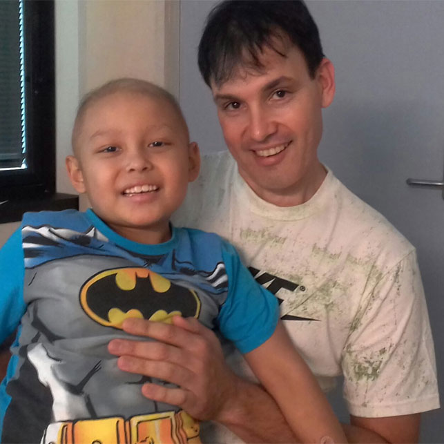 Micah with his dad Jason Murdoch at the hospital.