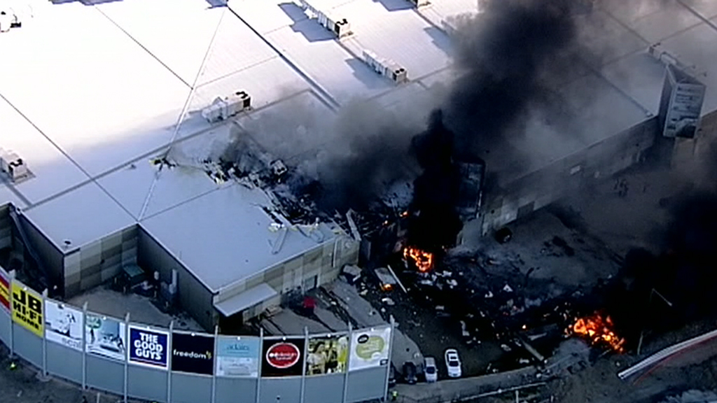 Five people are believed to have been on board a charter plane that crashed in a Melbourne direct factory outlet and exploded.