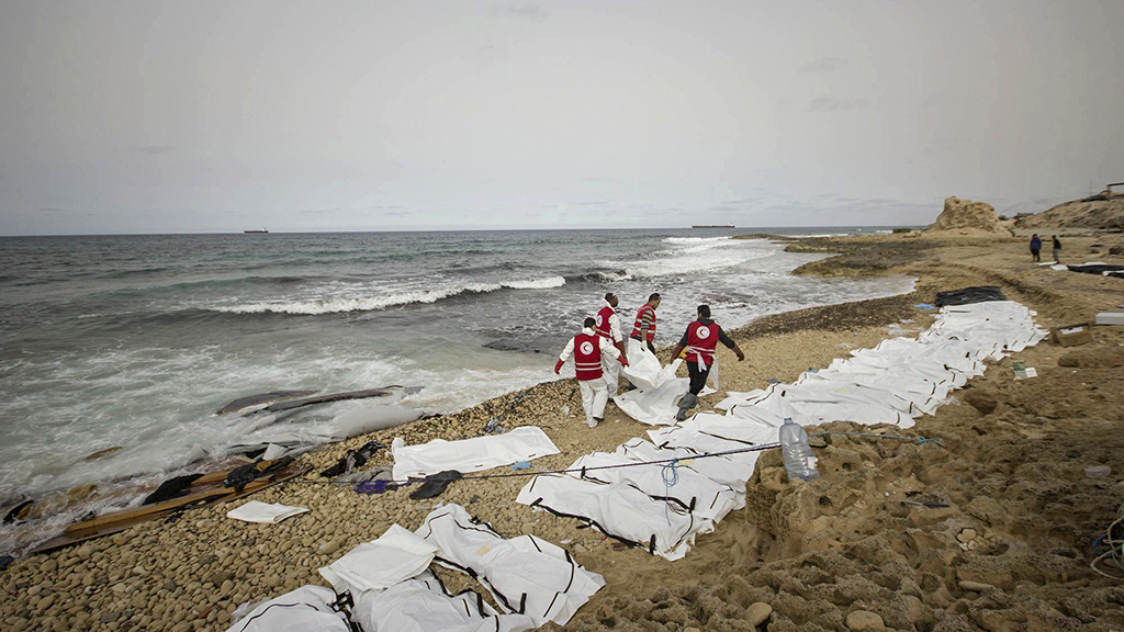 Bodies of 74 migrants trying to reach Europe found washed up on Libyan beach