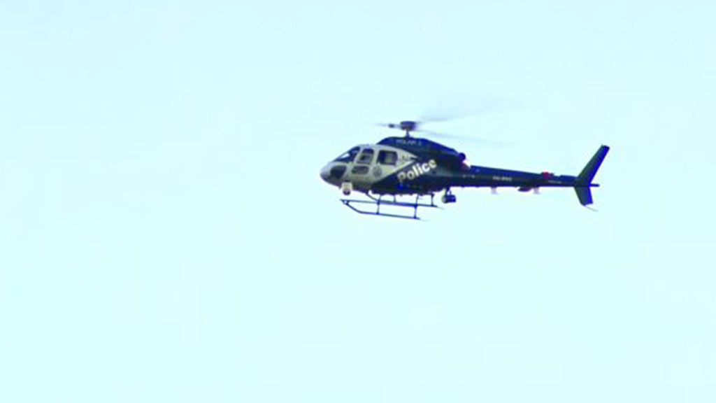 A POLAIR helicopter hovered over head. (9NEWS)
