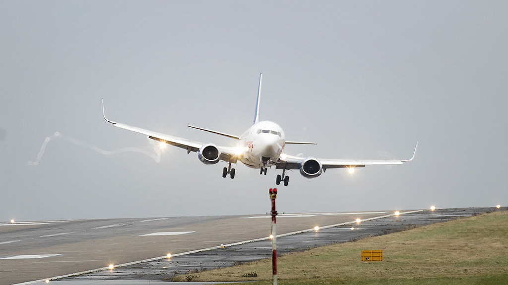 A plane buffeted by strong winds as it comes in to land at Leeds Bradford Airport. (AAP)