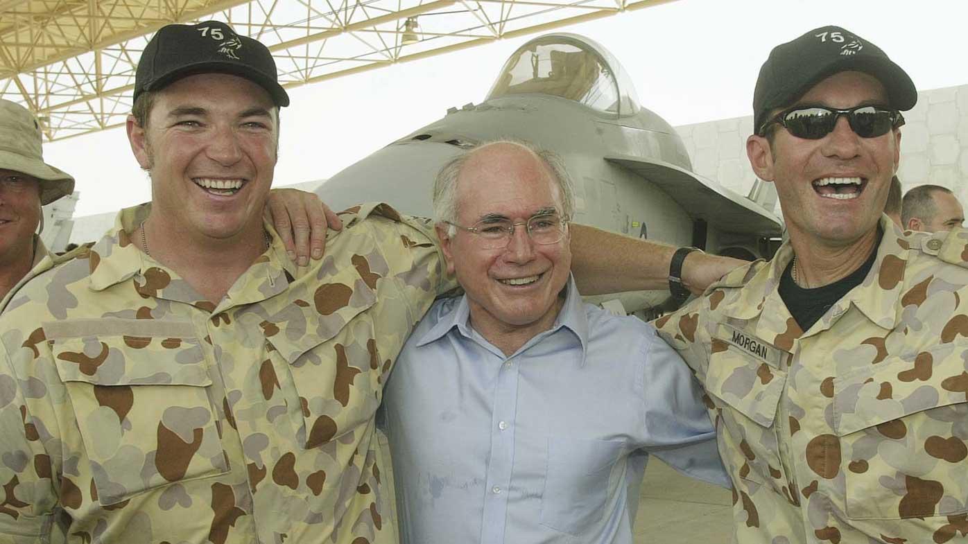 John Howard with Australian Army troops in Iraq. (AAP)