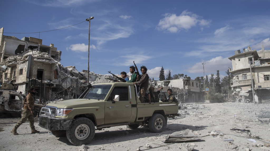 Members of the Free Syrian Army have worked to clear land mines from al-Bab. (AFP)