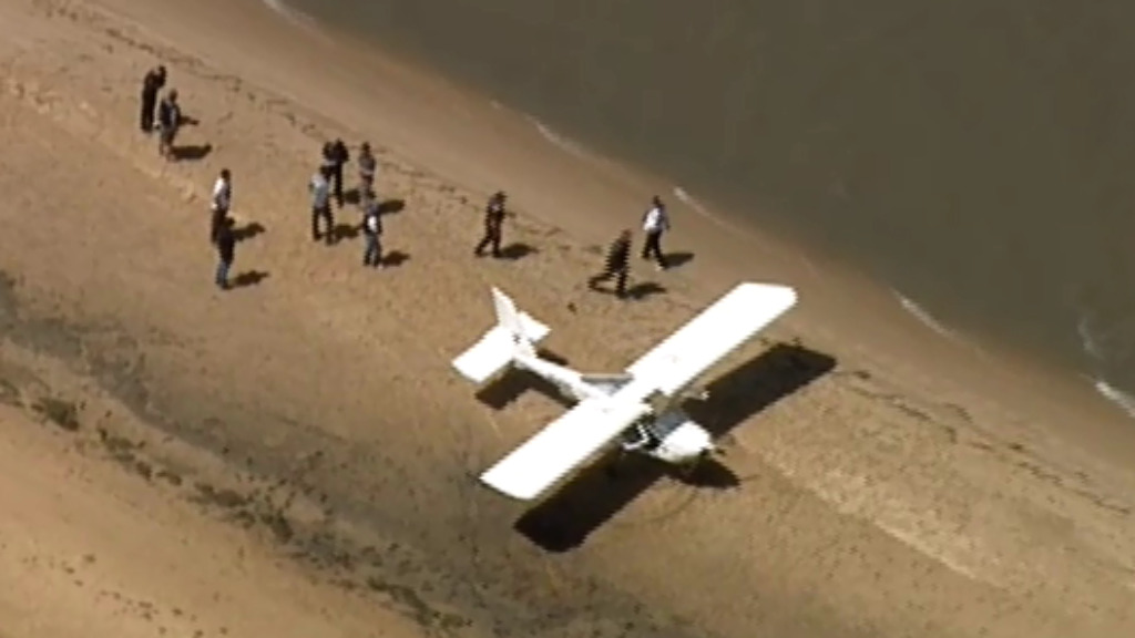 Plane stuck in sand after landing at remote beach in Victoria