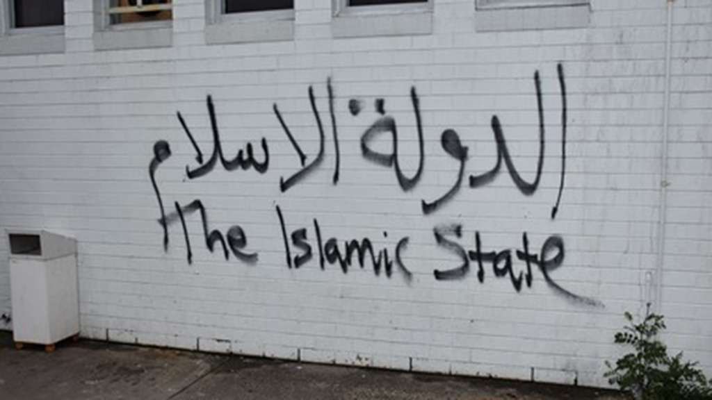 The words 'The Islamic State' were written across the mosque during one of the arson attacks. (Victoria Police)