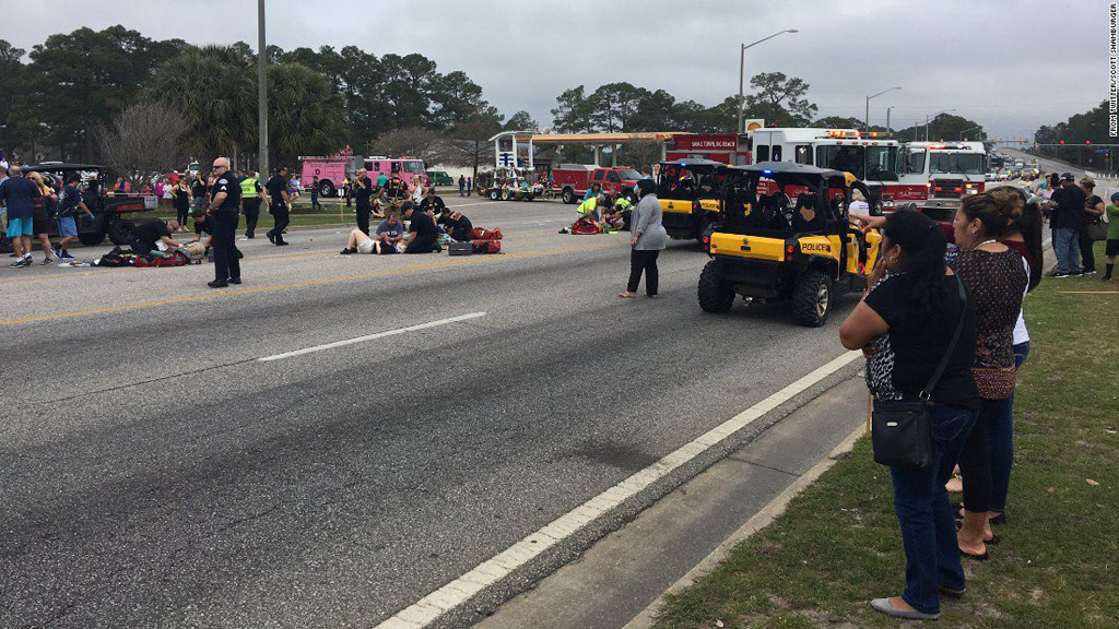 Up to 11 high school students injured after car ploughs into crowd during Mardi Gras parade