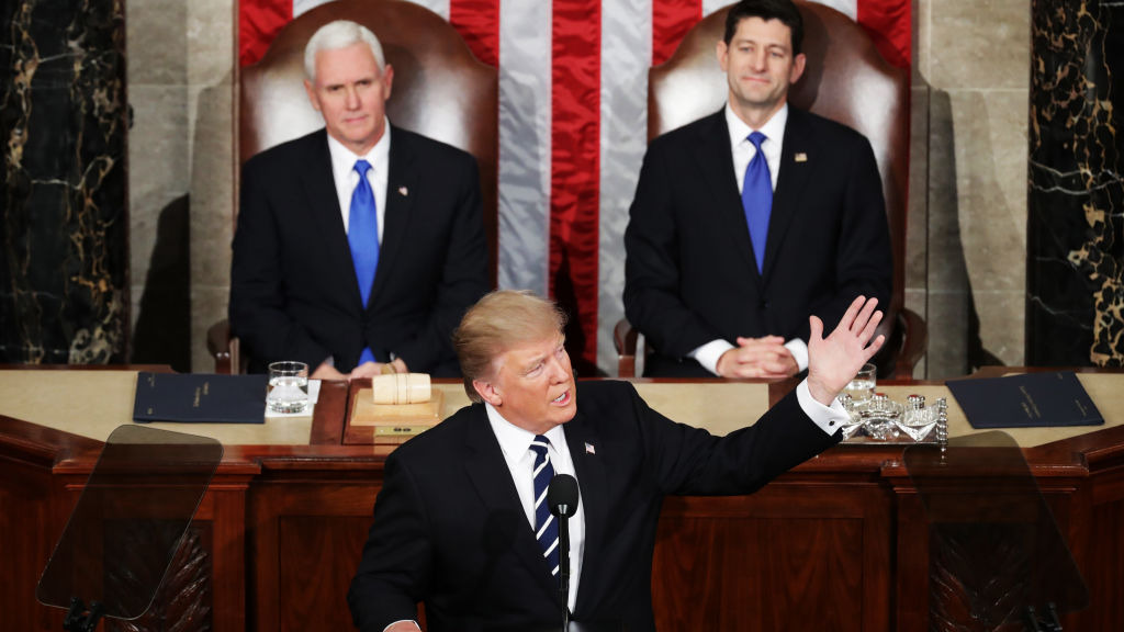 Mr Trump was flanked by Vice President Mike Pence and Speaker Paul Ryan. (Getty)