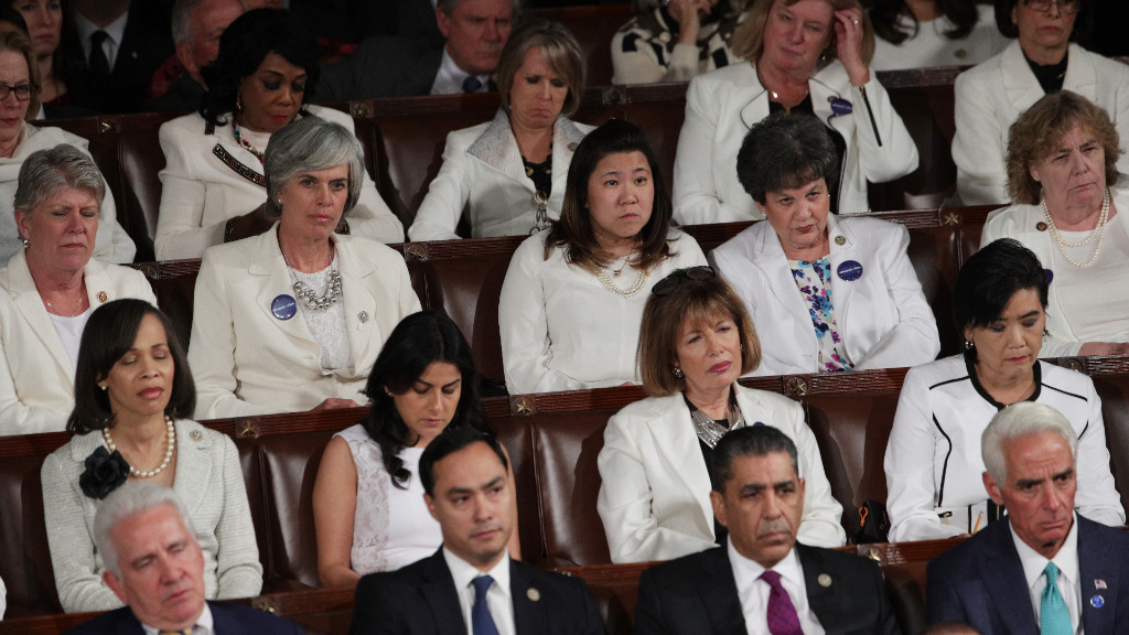 Democratic women are wearing white in honour of women's suffrage. Some democrats are wearing blue ribbons for the American Civil Liberties Union. (Getty)