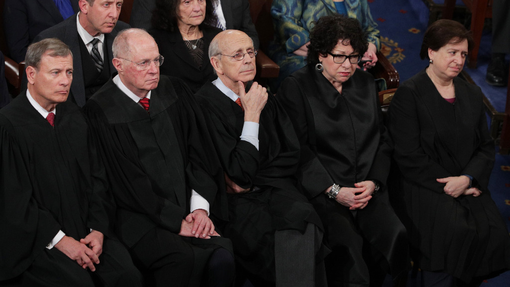 Supreme Court Chief Justice John Roberts, Supreme Court Associate Justice Anthony Kennedy, Supreme Court Associate Justice Stephen Breyer, Supreme Court Associate Justice Sonia Sotomayor and Supreme Court Associate Justice Elena Kagan look on. (AFP)