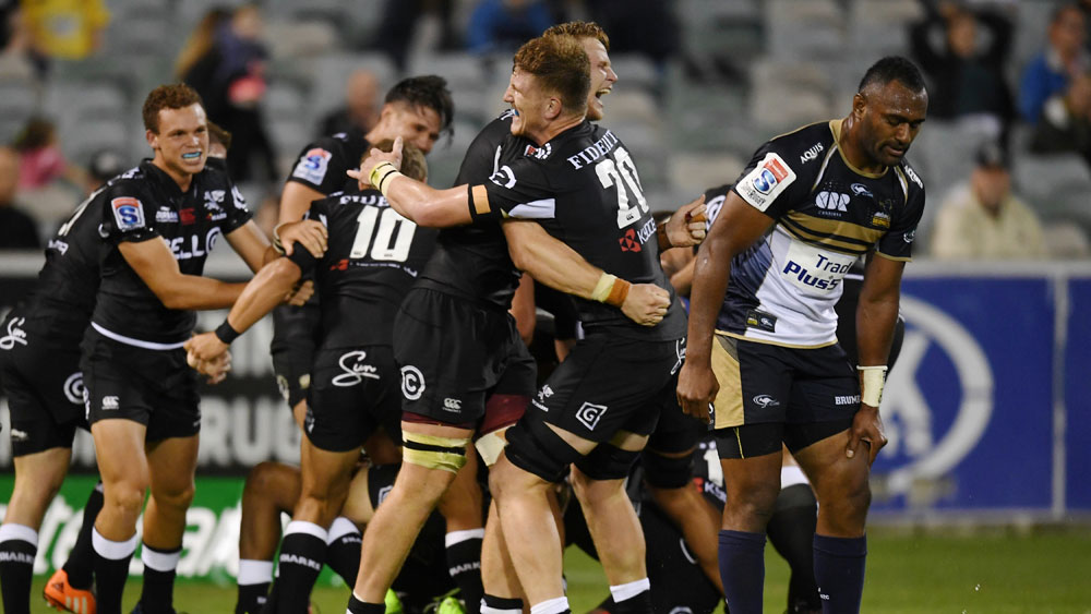 Celebrations after the Sharks score the match winning try against the Brumbies in Canberra. (AAP)