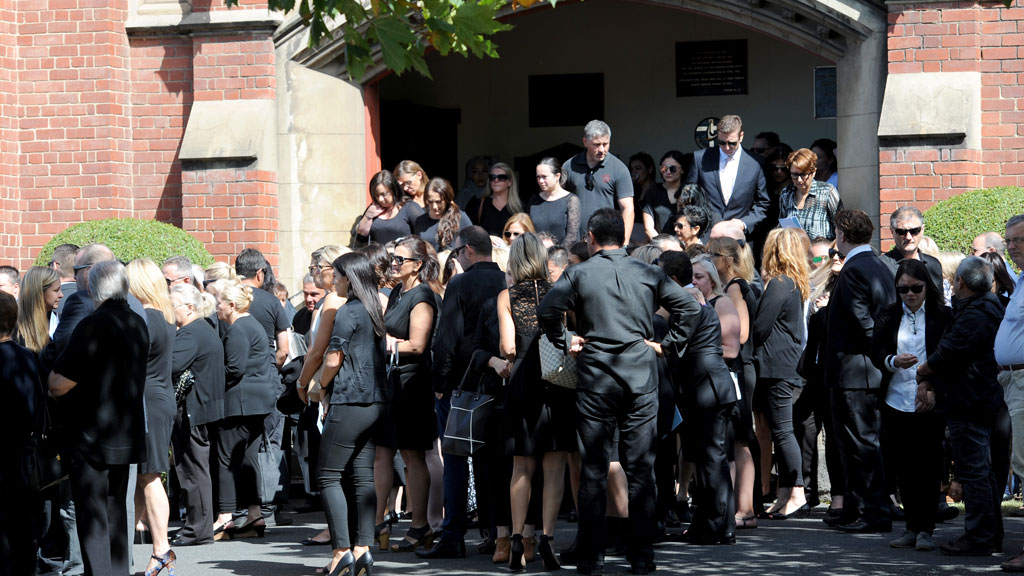 Mourners pay their final respects. (AAP)