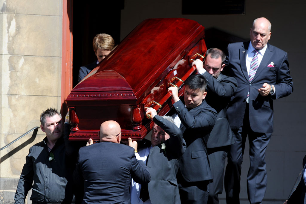The coffin is carried out of the church. (AAP)