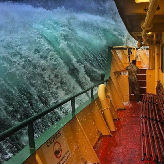 A deck worker on the Manly ferry caught the moment an enormous wave crashed alongside the boat. (Instagram: @ihaig72)
