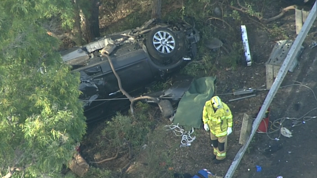 The two children and a second woman had to be freed from the wreckage. (9NEWS)