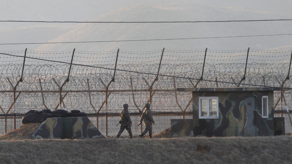 South Korean army soldiers patrolled a barbed-wire fence near the border with North Korea on the day of the launch. (AAP)