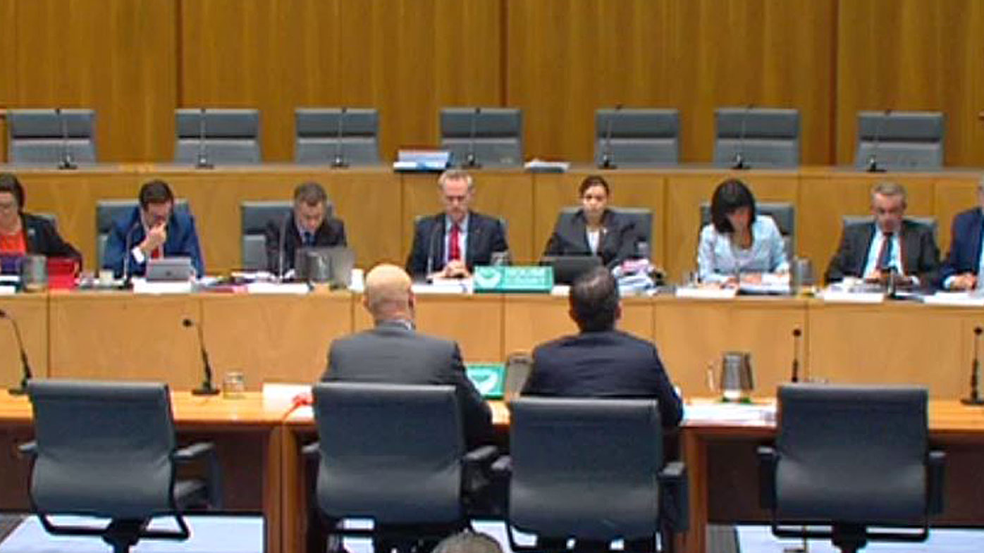 CBA boss Ian Narev (left) fronting a Senate committee.