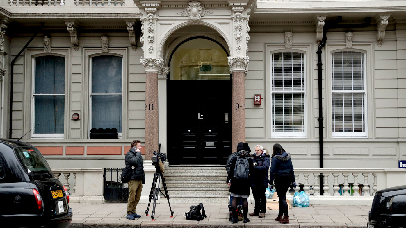 A file photo shows media outside the building that houses the offices of Orbis Business Intelligence Ltd, run by former MI6 agent Christopher Steele, in central London. (AAP)