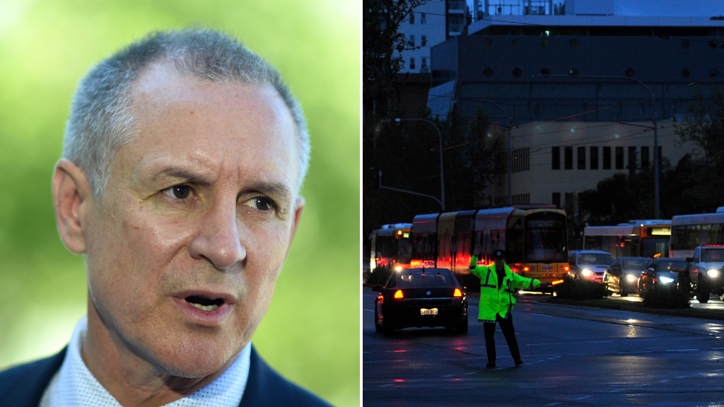 Premier Jay Weatherill (left), and a blackout in Adelaide last September (right). (AAP file image)