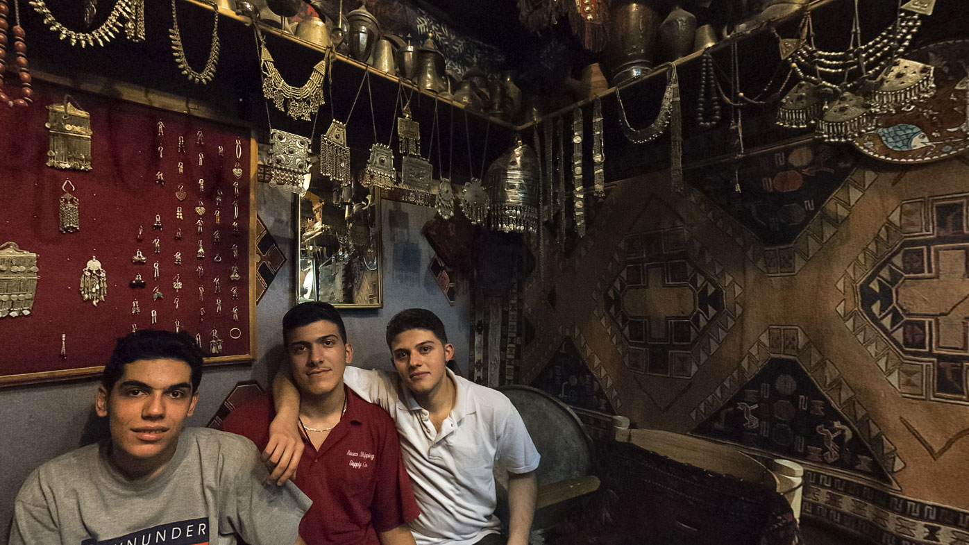 Some proud storeowners pose for a photo in the souq.