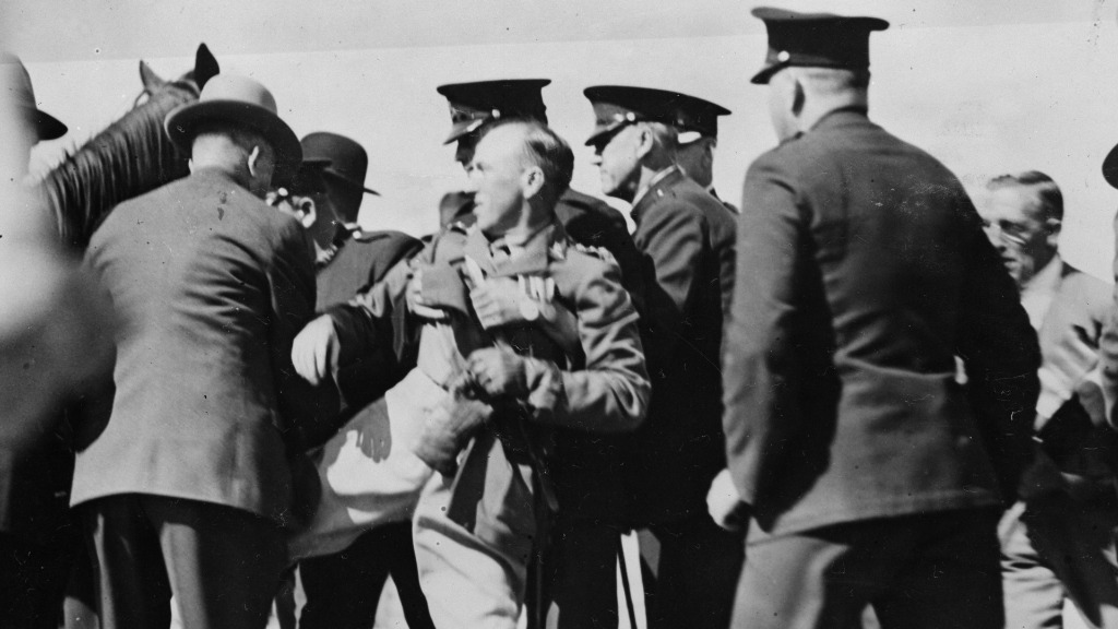 Authorities held back Francis De Groot after he slashed the opening ceremony ribbon of the Bridge. (Getty Images)