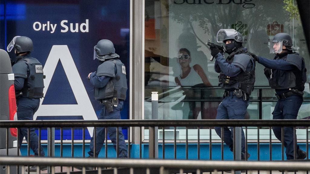 Armed police special intervention units move into position at Orly airport. (AAP)