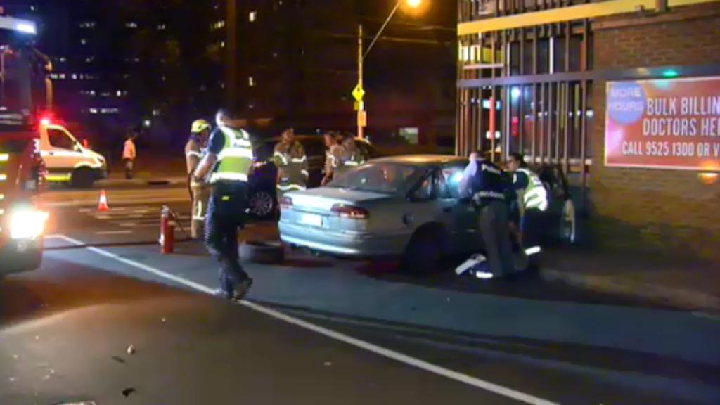 Car crashes into Melbourne building after water bottle 'wedges under brake pedal'