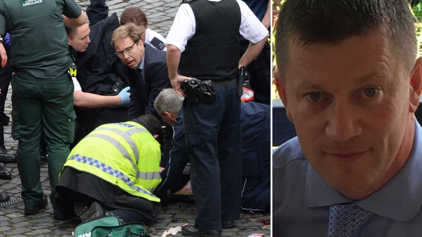 First responders, including MP Tobias Ellwood, working to revive PC Keith Palmer. (AAP/Supplied)