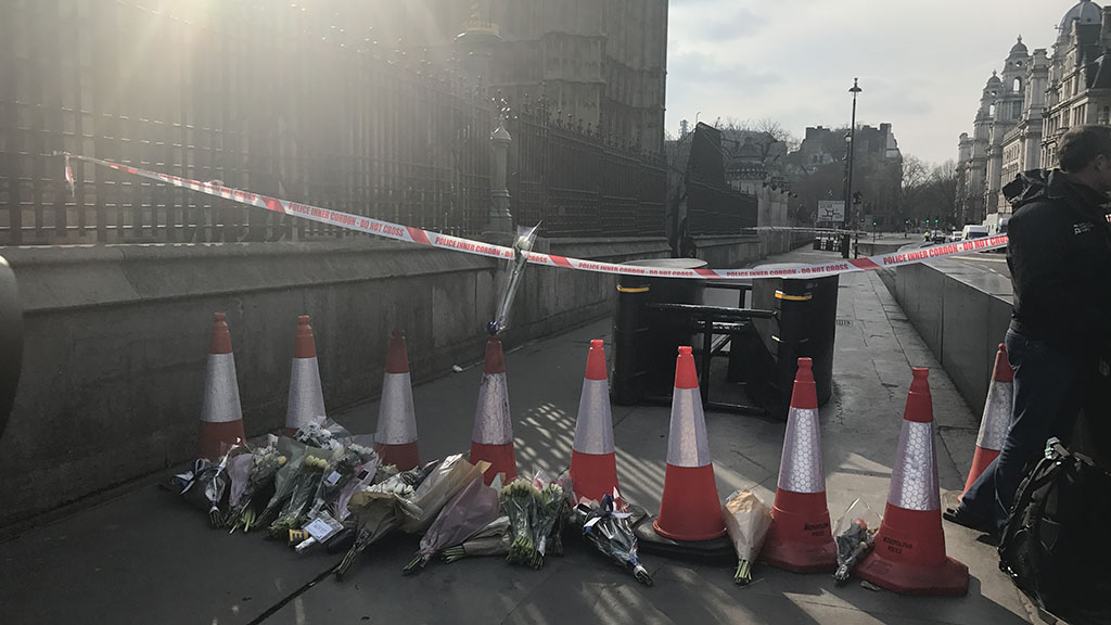 Londoners have started leaving flowers at the scene of the attack. (Gabrielle Adams/9NEWS)