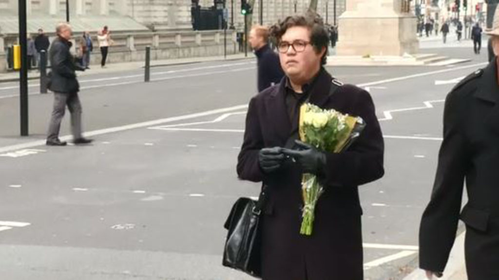 One man, whose friend was injured in the attack, visiting Westminster to leave flowers. (Reuters)