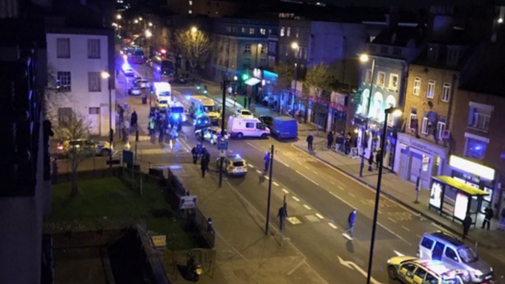 Four people injured and man arrested after car mounts London street