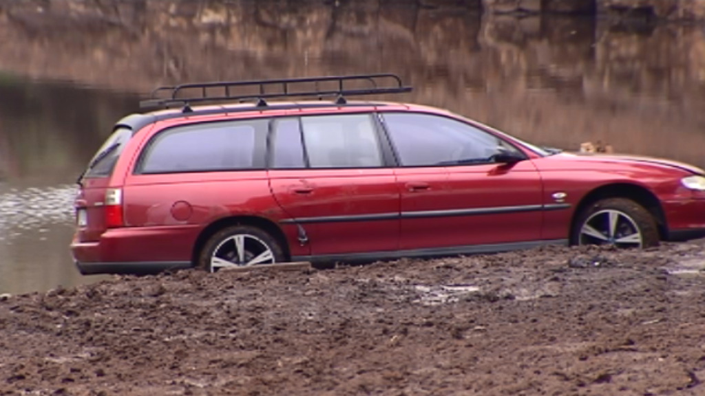 Victorian man seriously injured after being trapped under bogged car