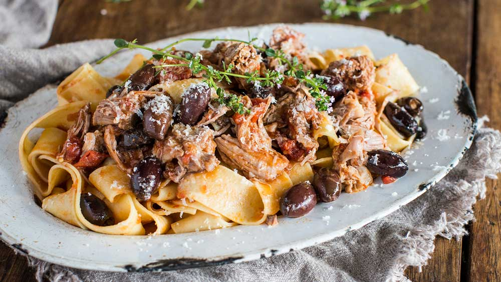 Slow cooked lamb ragu with olives and pappardelle