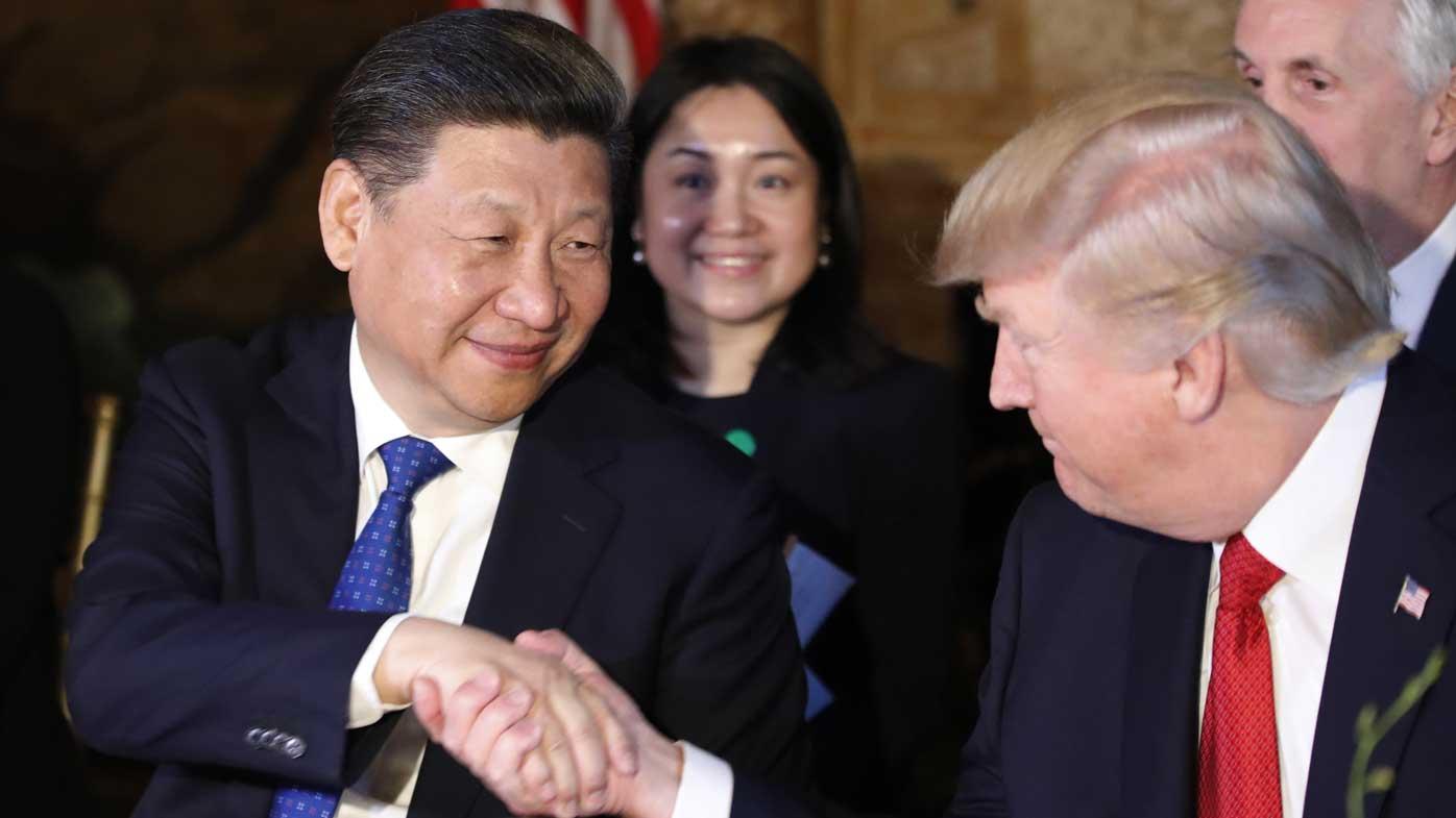 Xi Jinping shakes hands with Donald Trump. (AAP)
