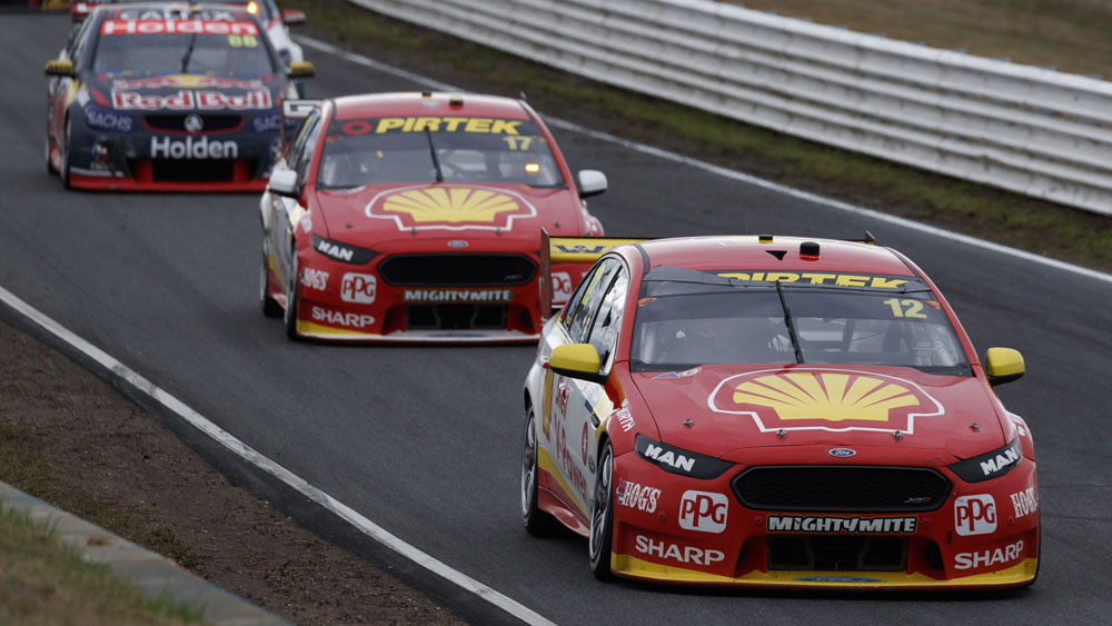Ford teammates Fabian Coulthard (right) and Scott McLaughlin (centre).