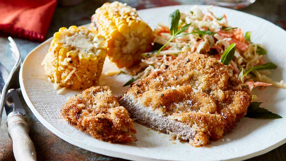 Rosemary beef schnitzel with coleslaw and corn recipe