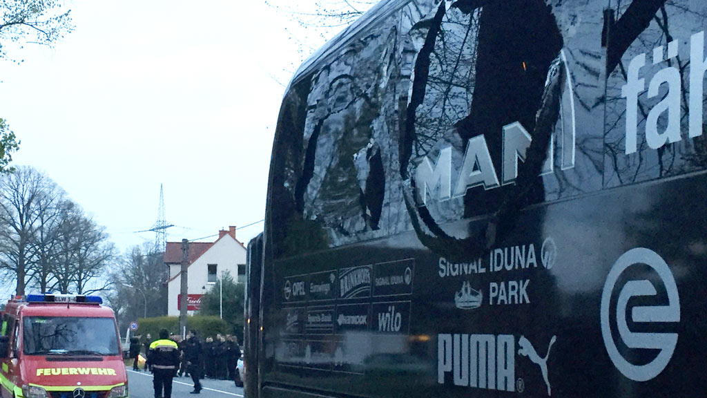 The damaged bus of Borussia Dortmund is pictured after an explosion some 10km away from the stadium prior to the UEFA Champions League 1st leg quarter-final football match BVB Borussia Dortmund v Monaco in Dortmund, western Germany on April 11, 2017. (AFP)