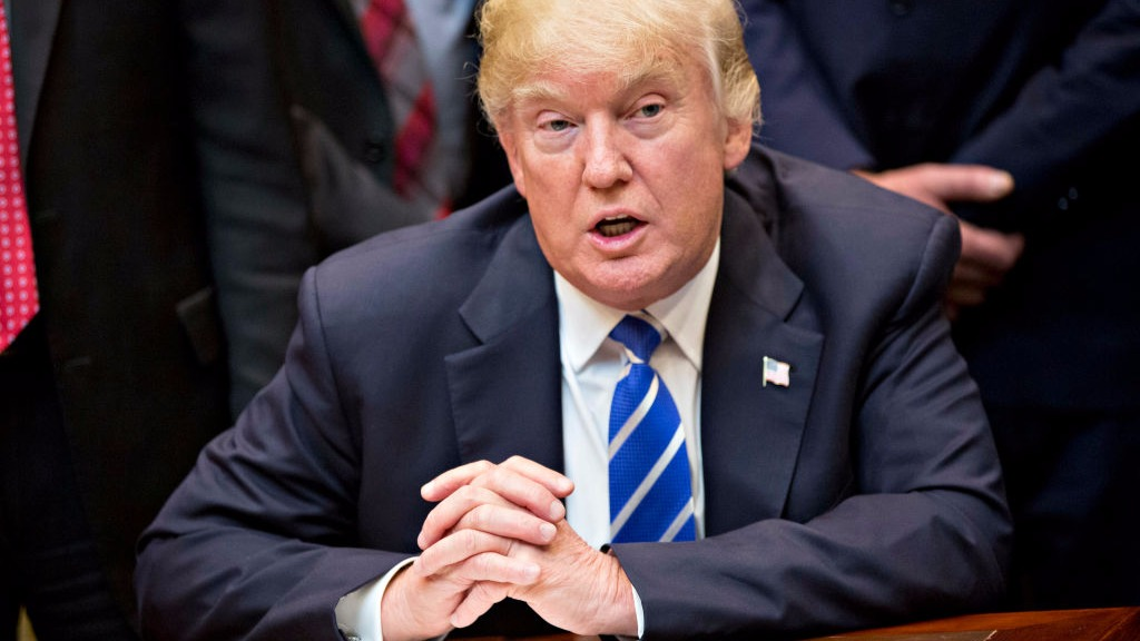 Trump signs law rolling back US abortion clinics funding protection