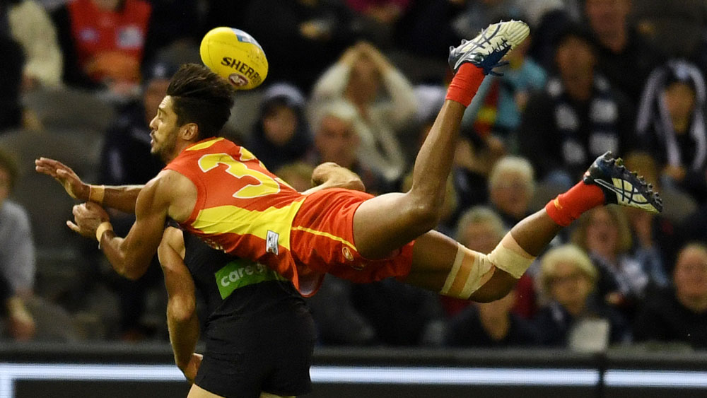 Gold Coast player Aaron Hall attempts to take a mark. (AAP)