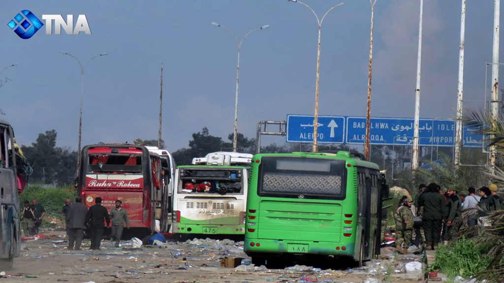 Buses at the evacuation point where an explosion hit at the Rashideen area, a rebel-controlled district outside Aleppo city. (AAP)