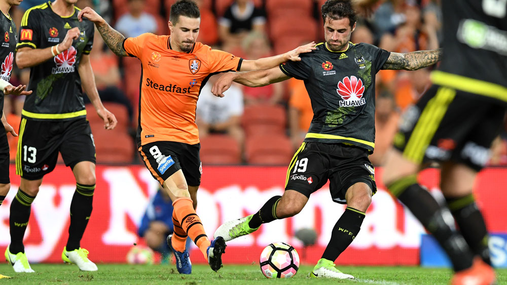 Brisbane striker Jamie Maclaren takes on the Phoenix. (AAP)