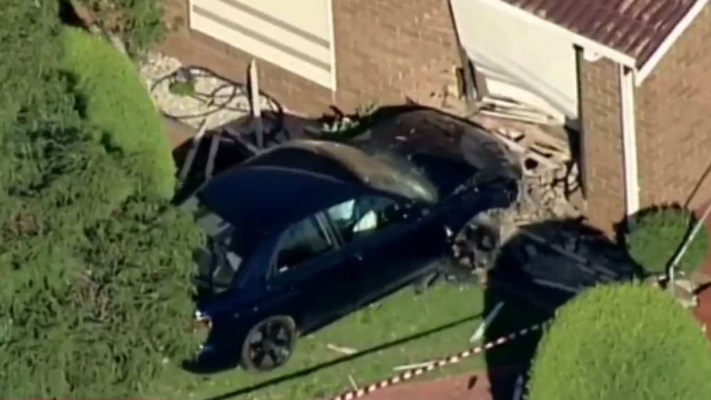 Naked man allegedly crashes car through Melbourne home