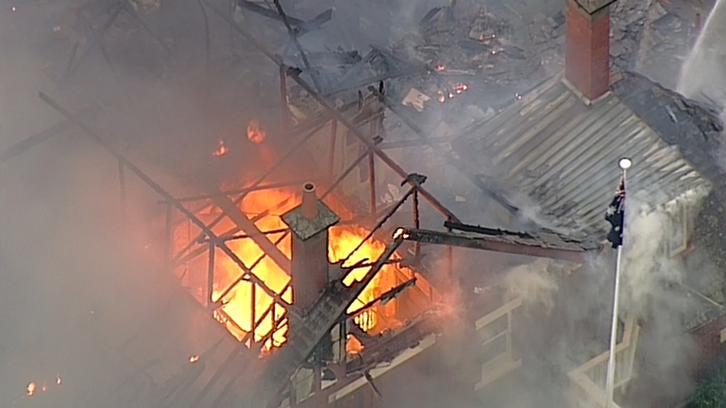 Flames have burned through the roof of the building. (9NEWS)