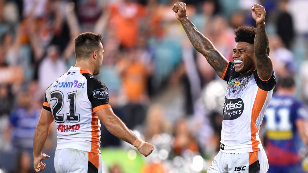 Wests Tigers halfback Luke Brooks (l) and Kevin Naiqama.