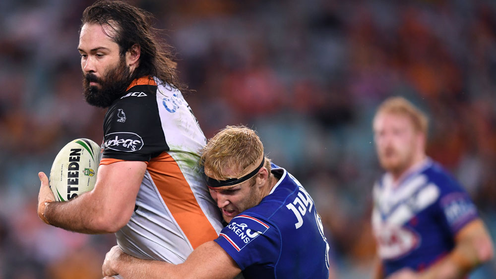 Wests Tigers captain Aaron Woods (l) and Canterbury Bulldogs prop Aiden Tolman.