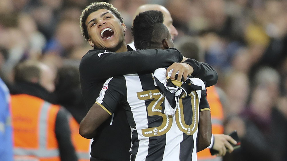 Newcastle United's Christian Atsu (r).